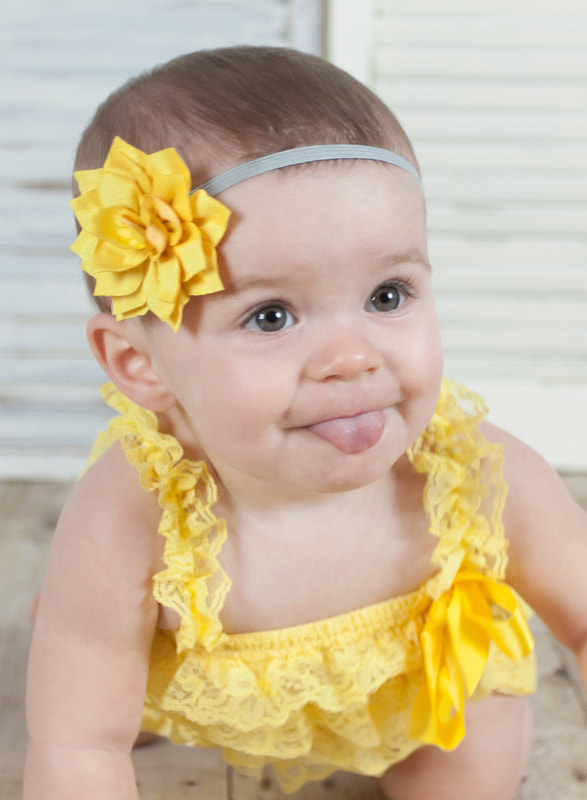 one year old photography baby girl in yellow
