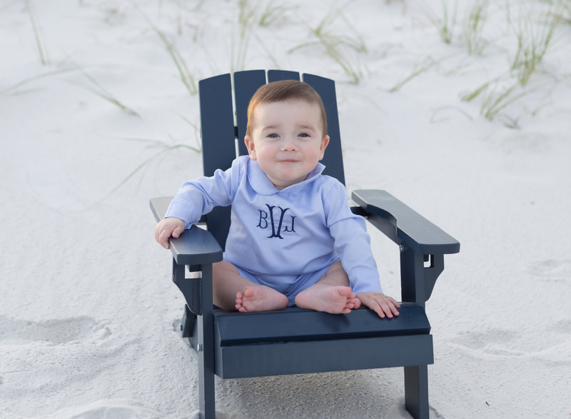 baby photography of six month old baby on a beach in blue in a chair
